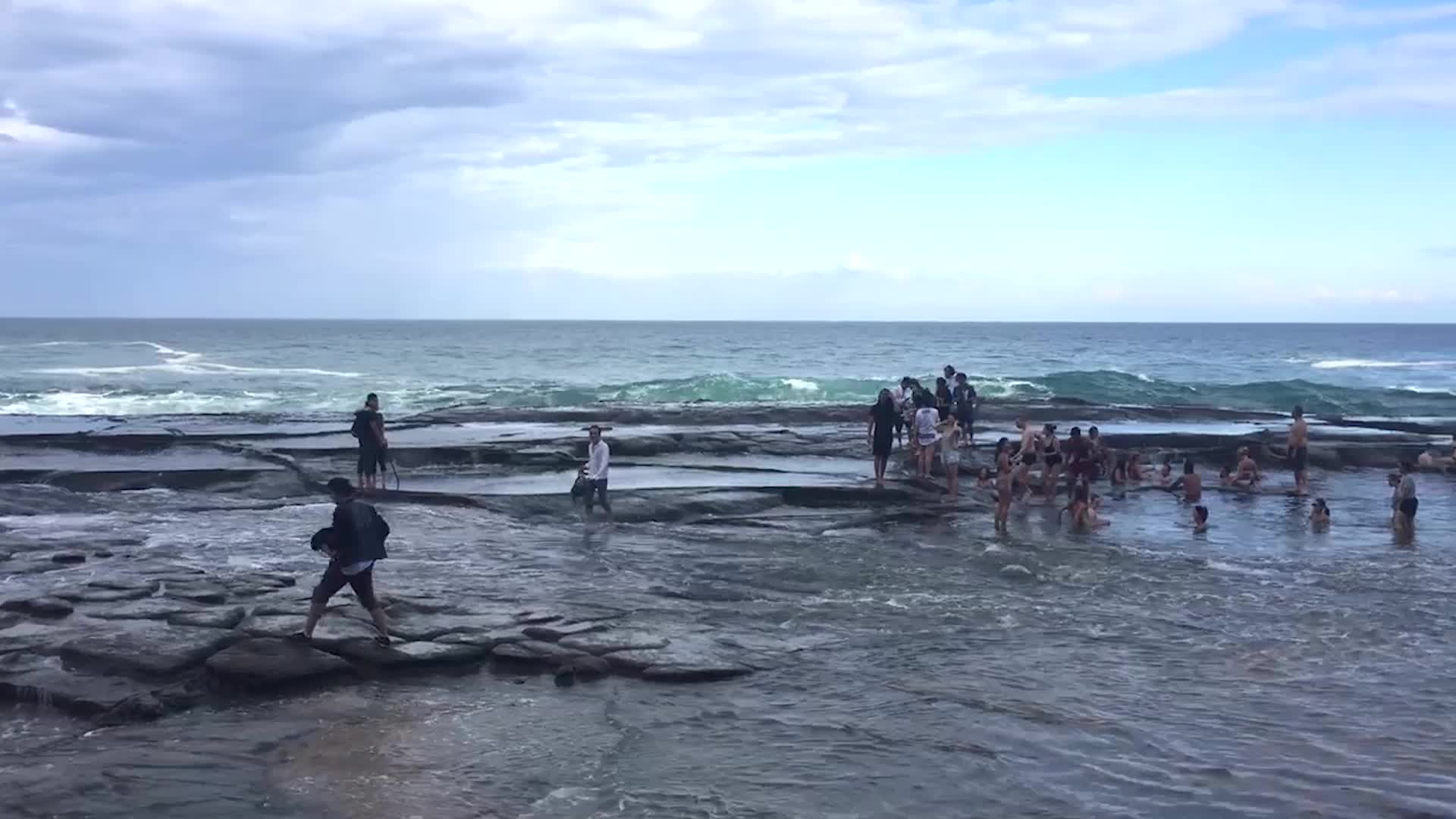 A huge wave caught the tourists on a beach in New South Wales, Australia by surprise.
