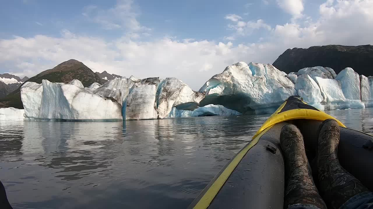 A group of kayakers caught the moment a calving event happened at Spencer Glacier in Alaska. A glacier bridge collapsed right in front of them, sending a massive splash.