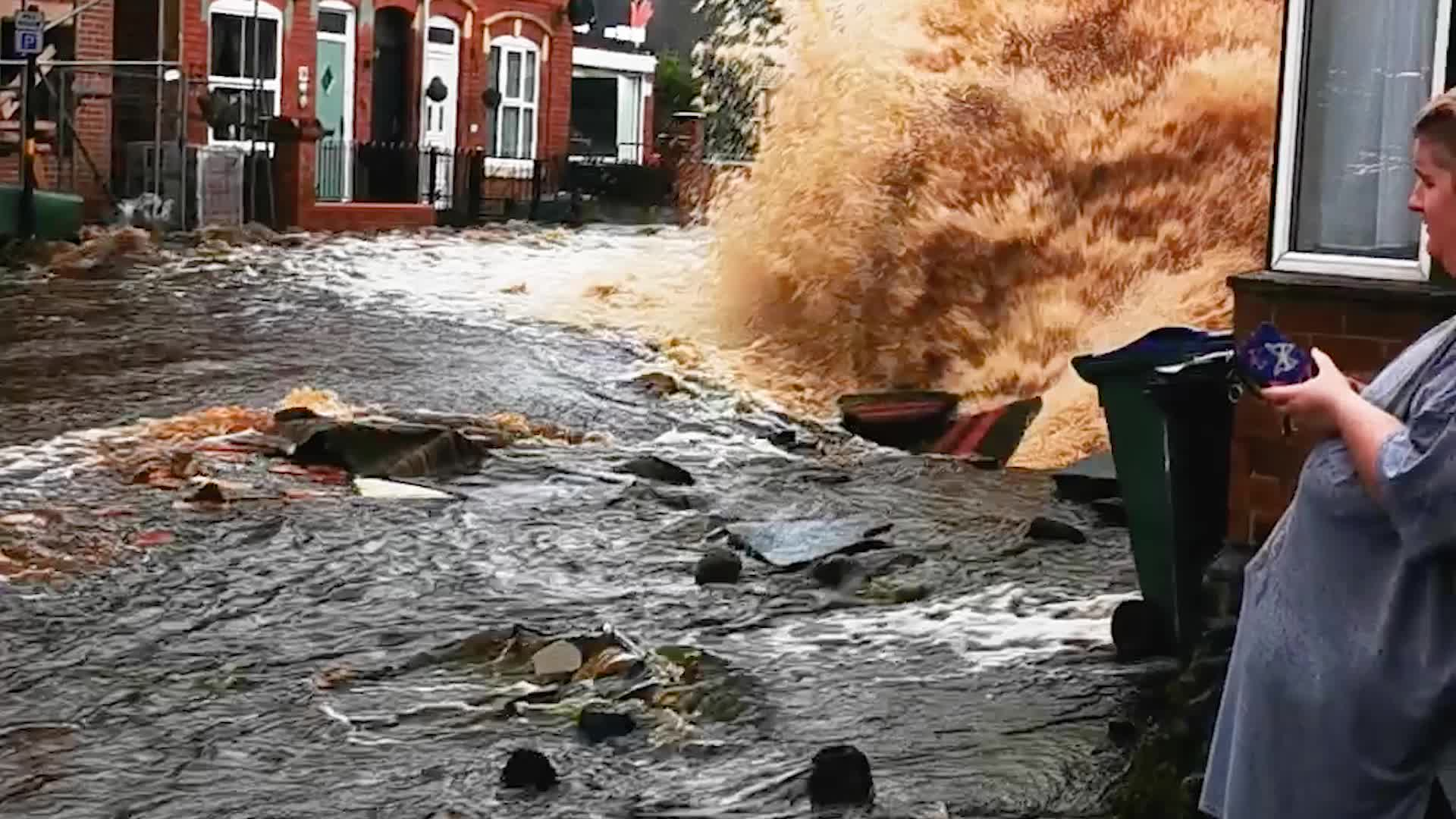 A major water main break sent an explosion of water and flooded houses in Tipton just northwest of Birmingham in the U.K. The floodwaters damaged houses and prompted evacuations.