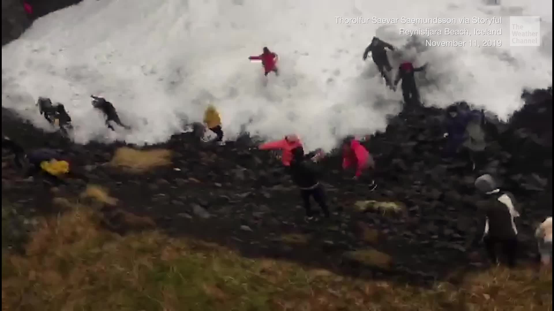 "Some tourists who strayed too close to the surf on an Iceland beach were knocked down by the beach's notorious ""sneaker waves."""