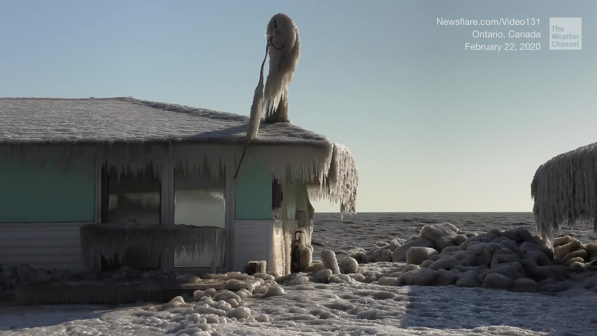 Brrrrr. Winds blow freezing rain onto Lake Erie's shore, encasing homes in Ontario, Canada, in ice.