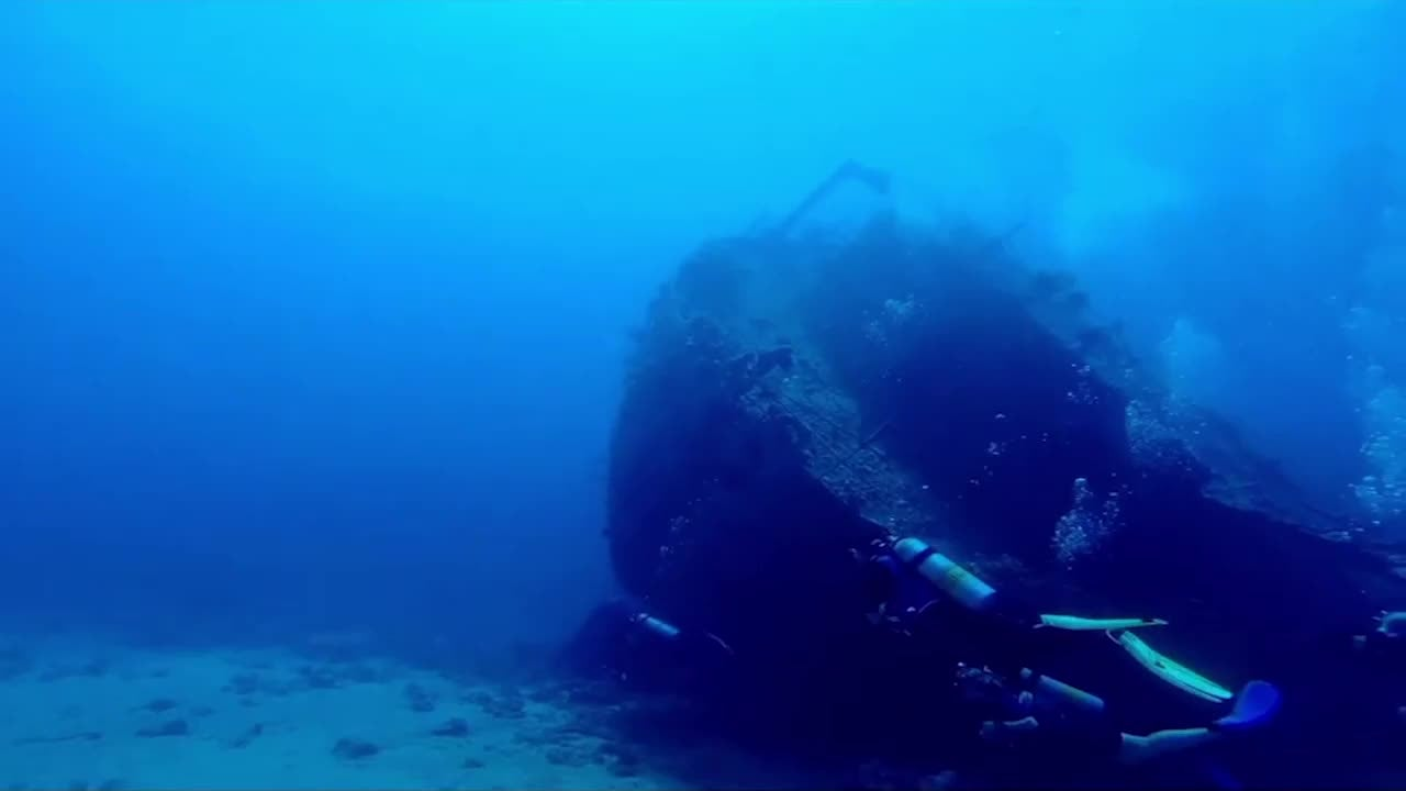 Take a look at a haunting underwater scene at the Chrisoula K shipwreck in the Red Sea near Egypt as scuba divers explore the popular attraction.