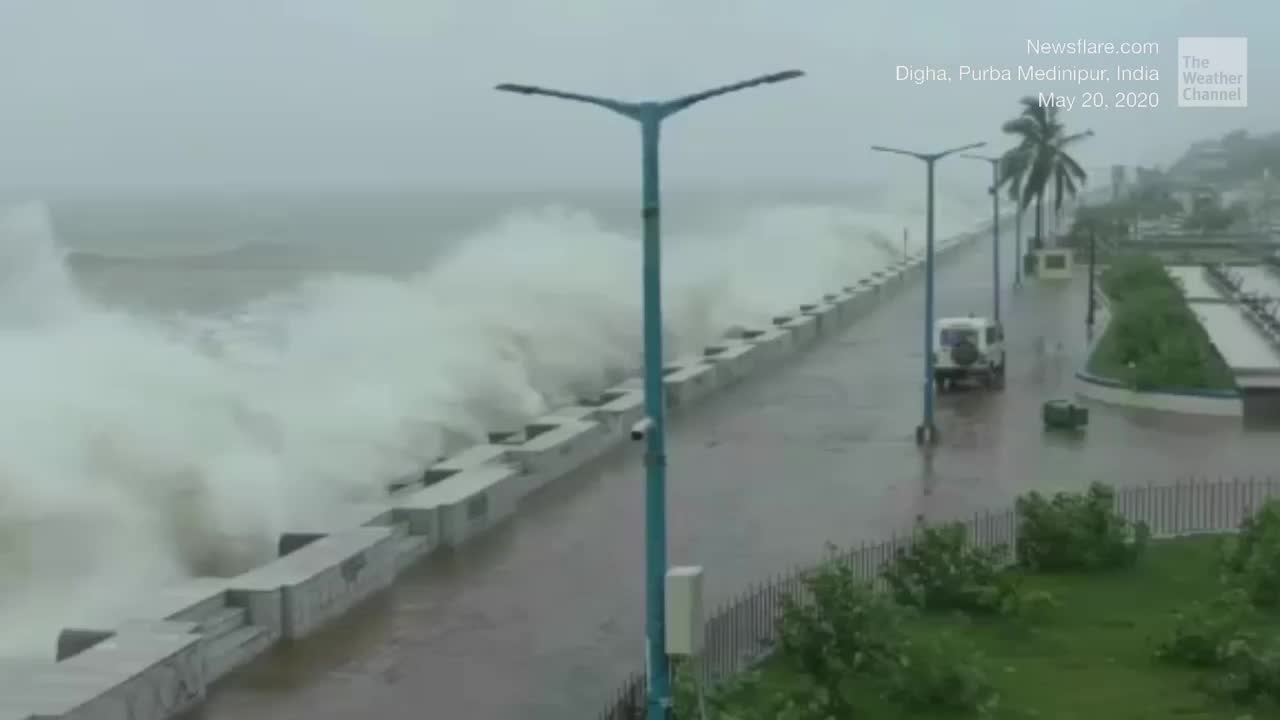 The cyclone is bringing huge waves and strong wind to India and Bangladesh as it roars ashore.