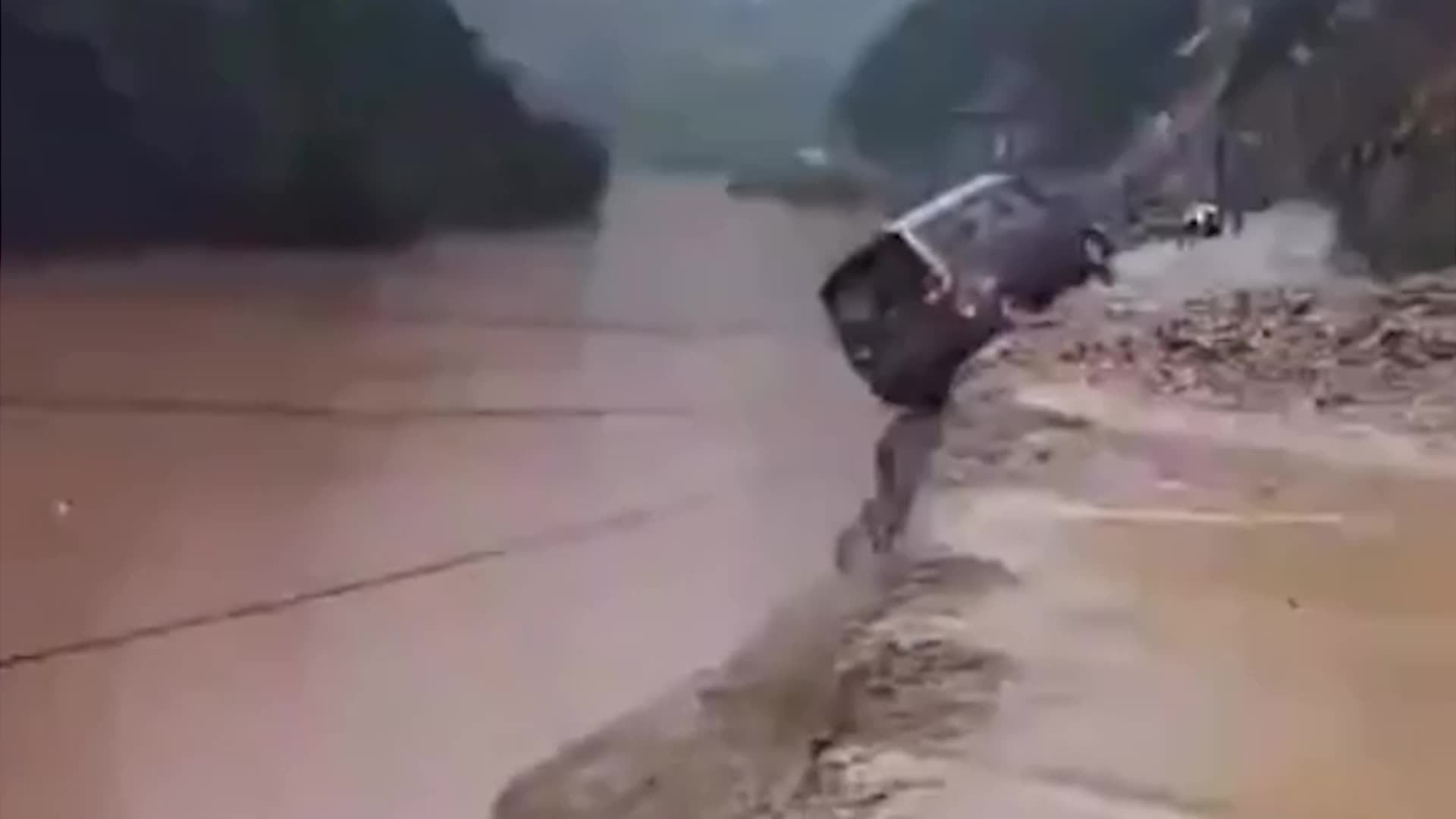 Residents flee as torrents of mud and debris tear through southwestern China, sweeping away cars and everything else in its path.