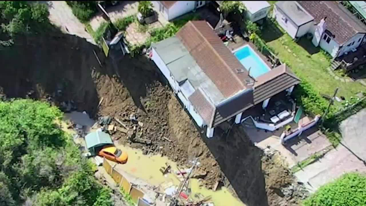 A large cliff collapse in the town of Eastchurch in Kent, England, left homes dangling and forced families to evacuate.