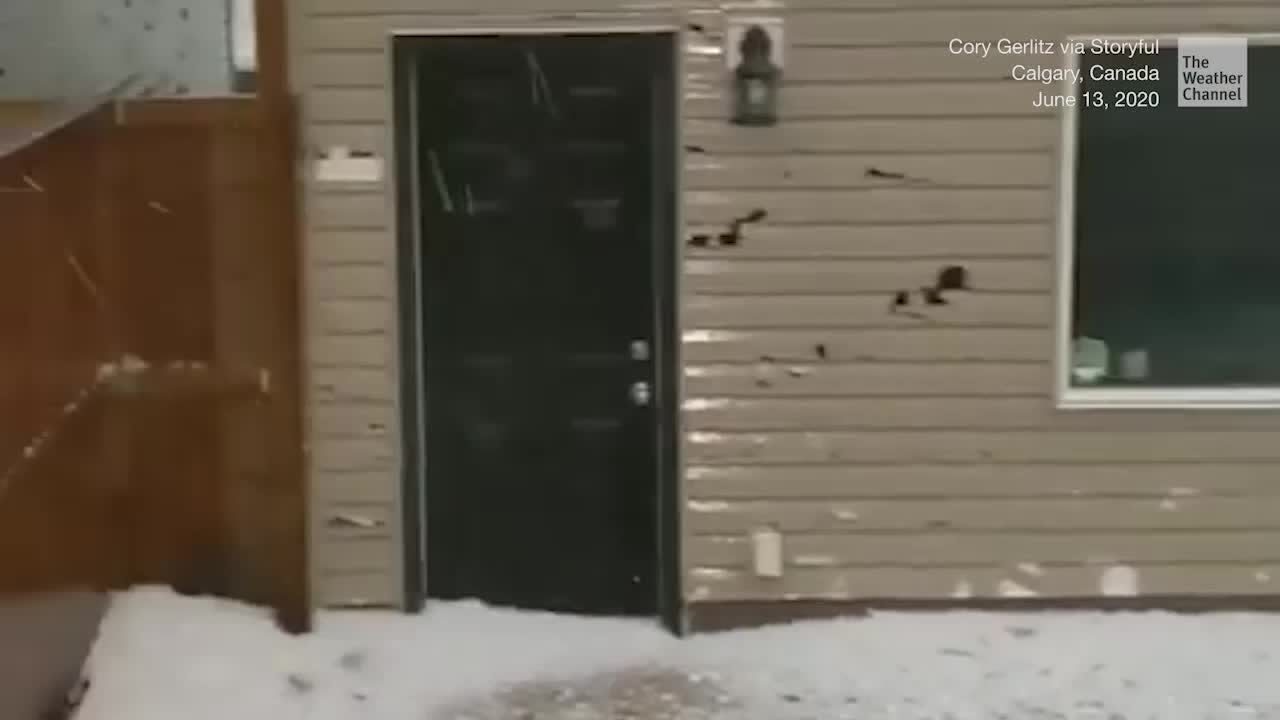 A violent storm drops massive chunks of ice from the sky, ripping the siding off home in Calgary, Canada.