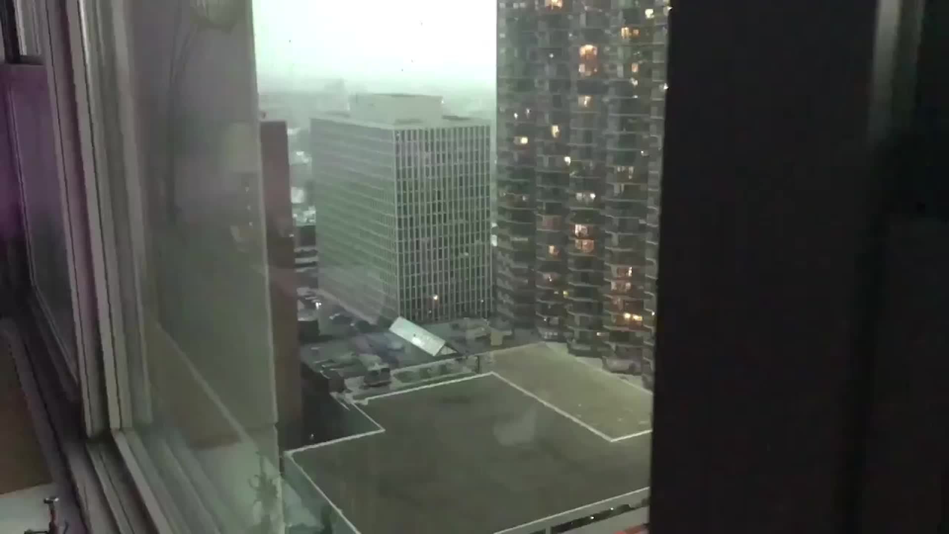 Shingles Fly Off Building on Chicago's Lake Shore Drive - Videos from The Weather Channel | weather.com