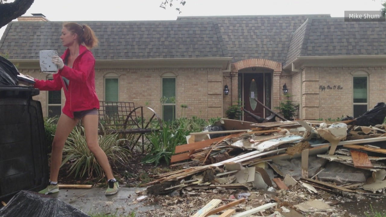 flood worry houston texas woman cleans up