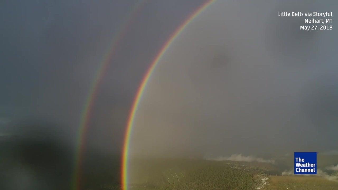 Stunning double full circle rainbow caught on camera