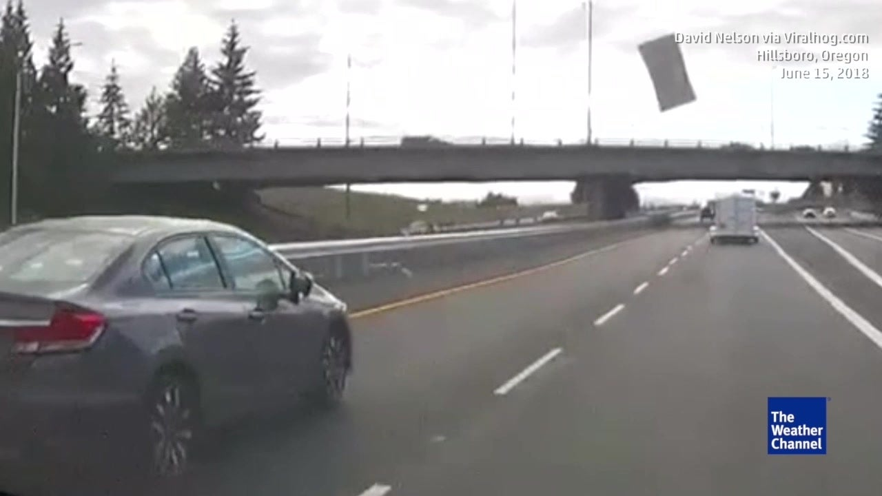 Watch Drywall Fly Off Truck into Traffic