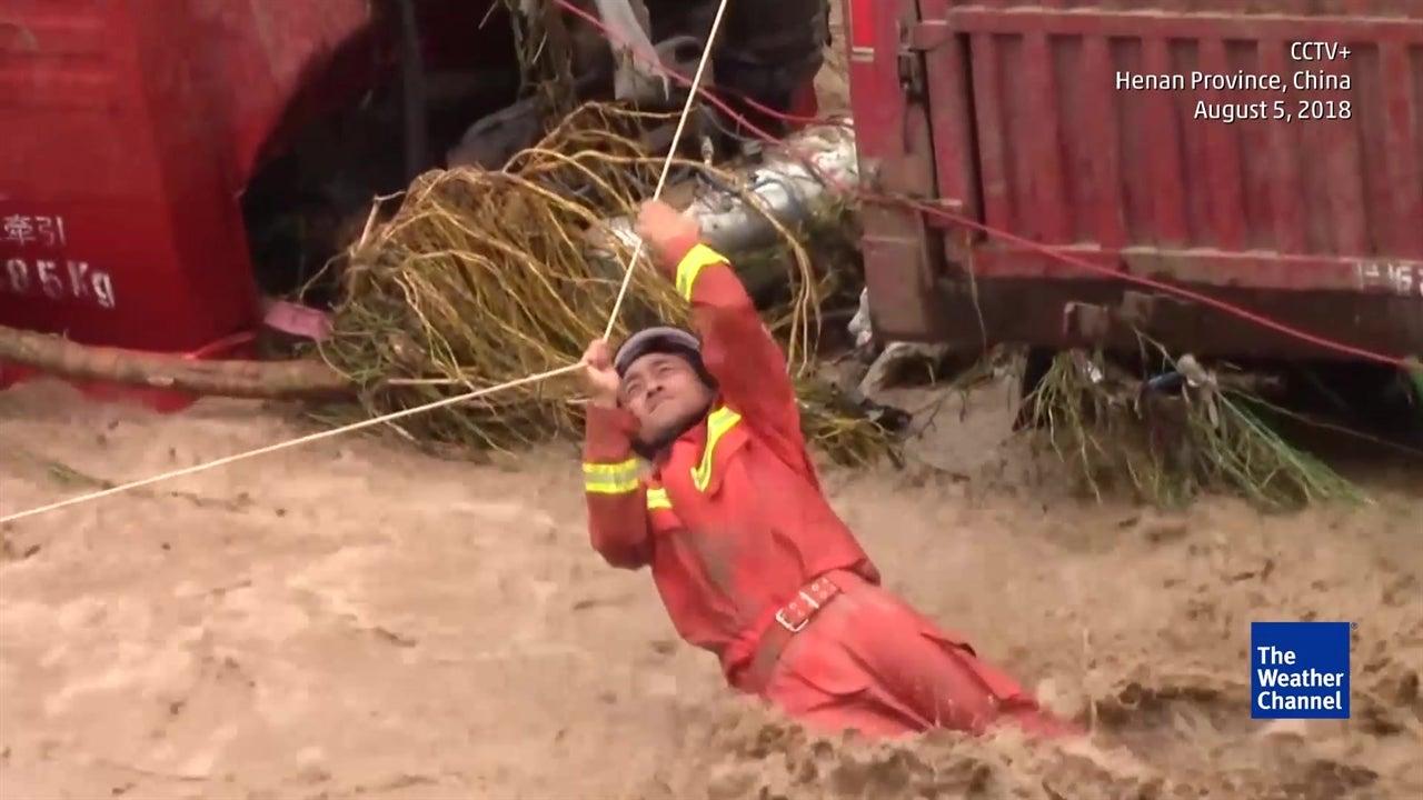 Astonishing footage captures dramatic rescue as flash floods hit China