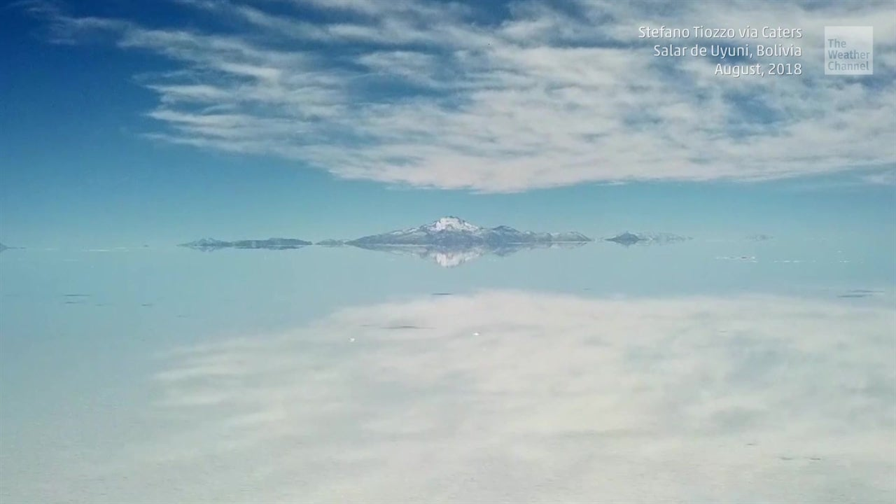 Heavy rains flood Bolivia's Salar de Uyuni salt desert, making it look like a giant mirror