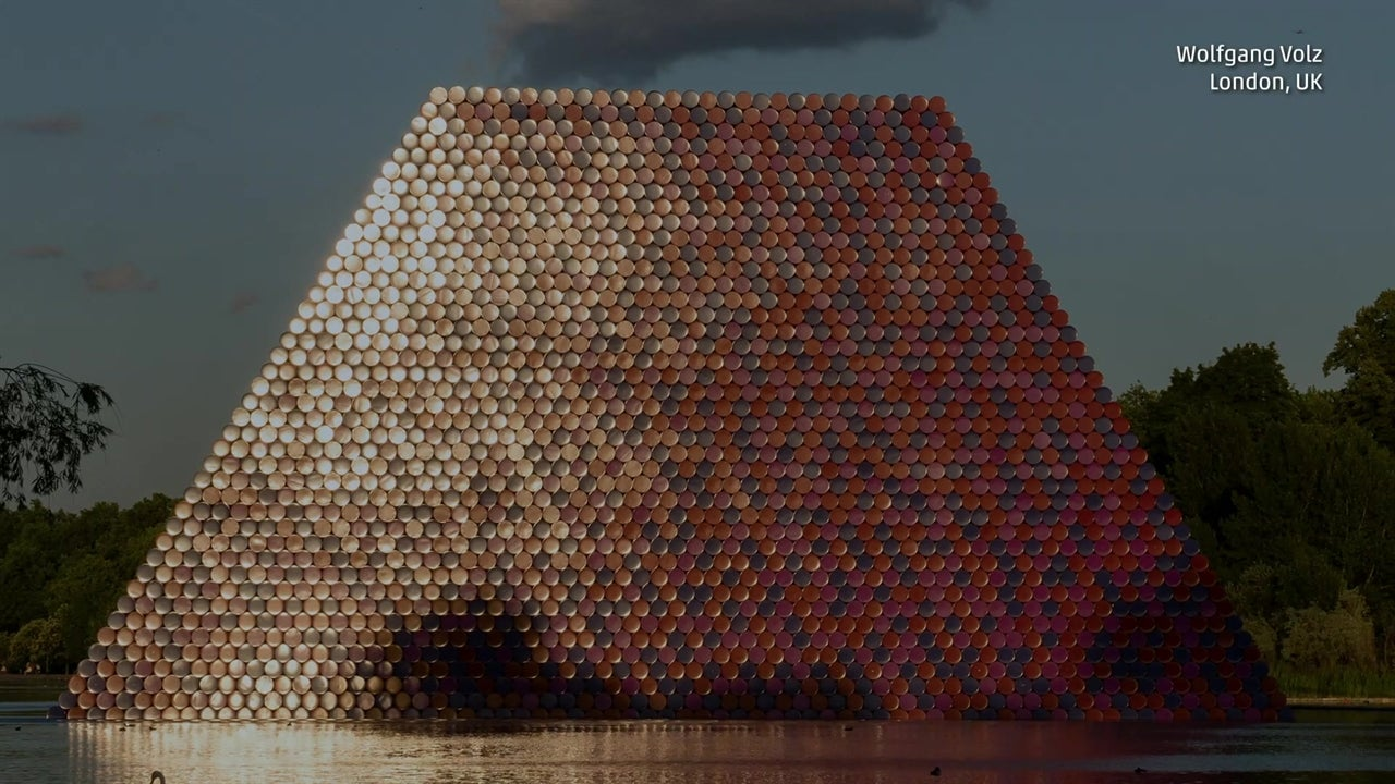 Artist constructs enormous pyramid on London lake