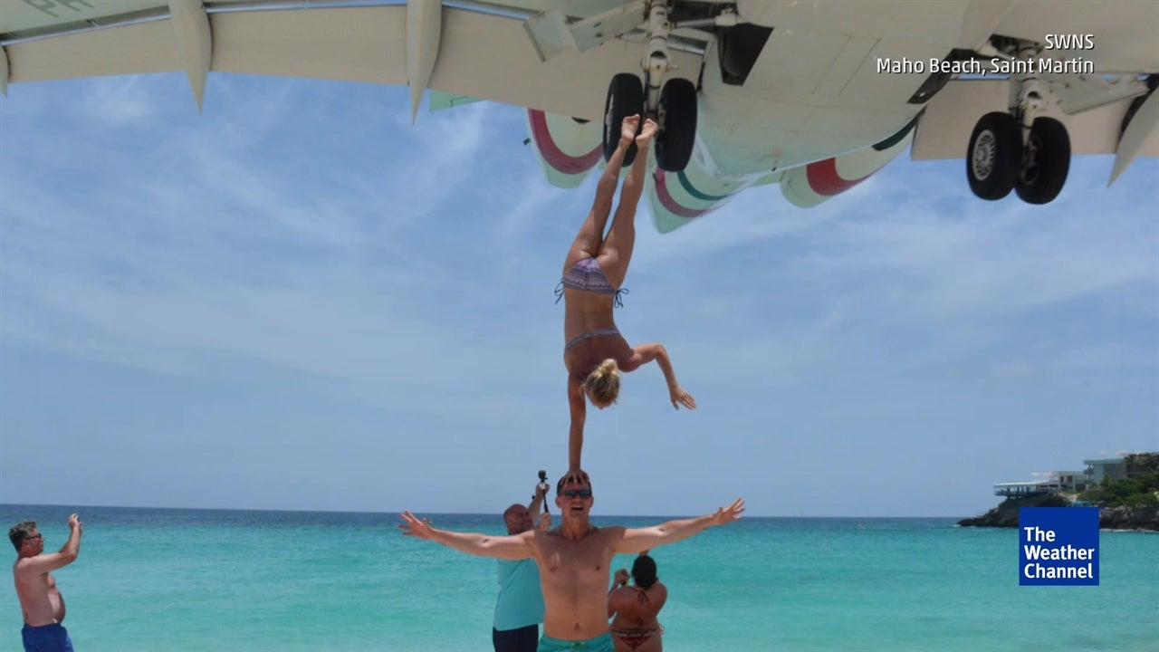 Couple Draws Social Media Flak For 'Handstand' Stunt In The Caribbean