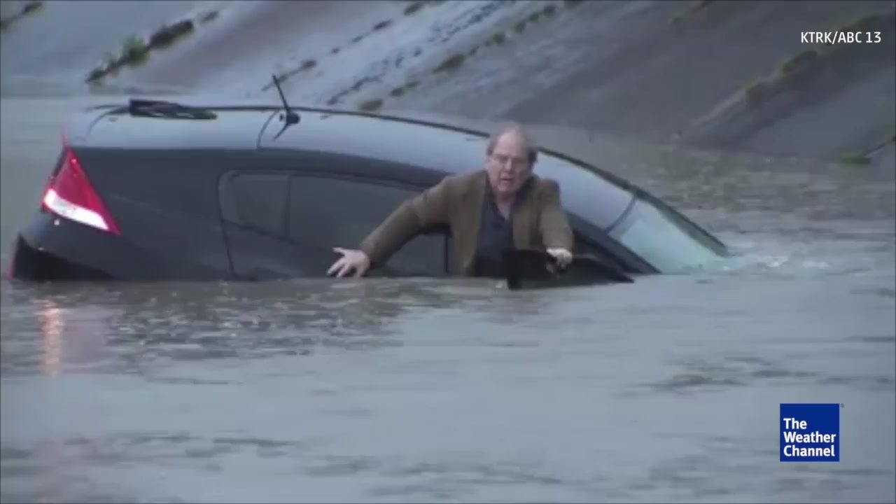 houston reporter jumps into flood water to save driver