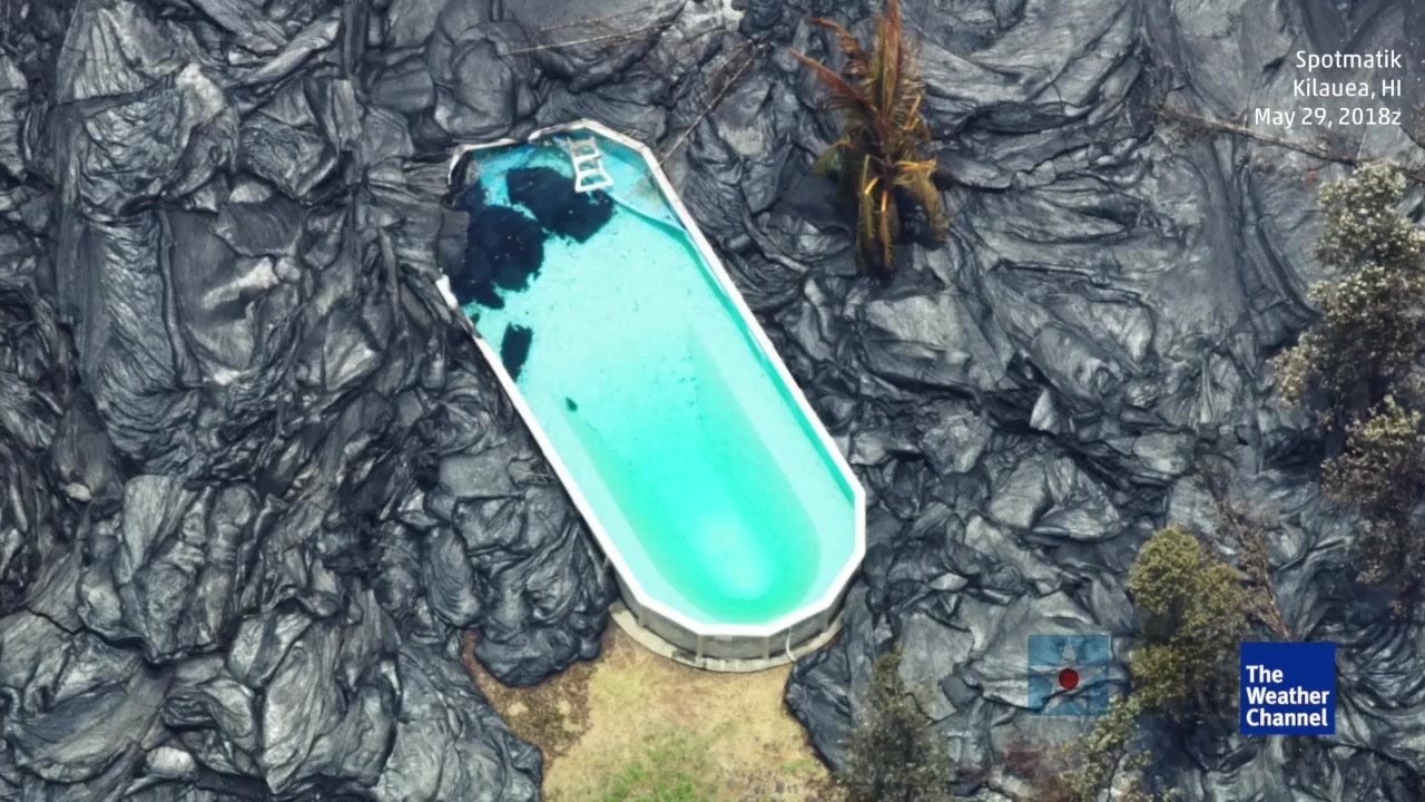 Flowing lava surrounds swimming pool in Hawaii