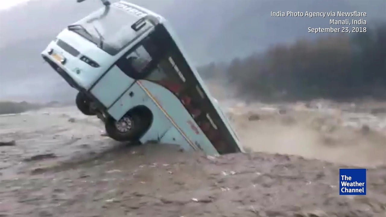 Shocking footage captures bus being swept away by floodwaters