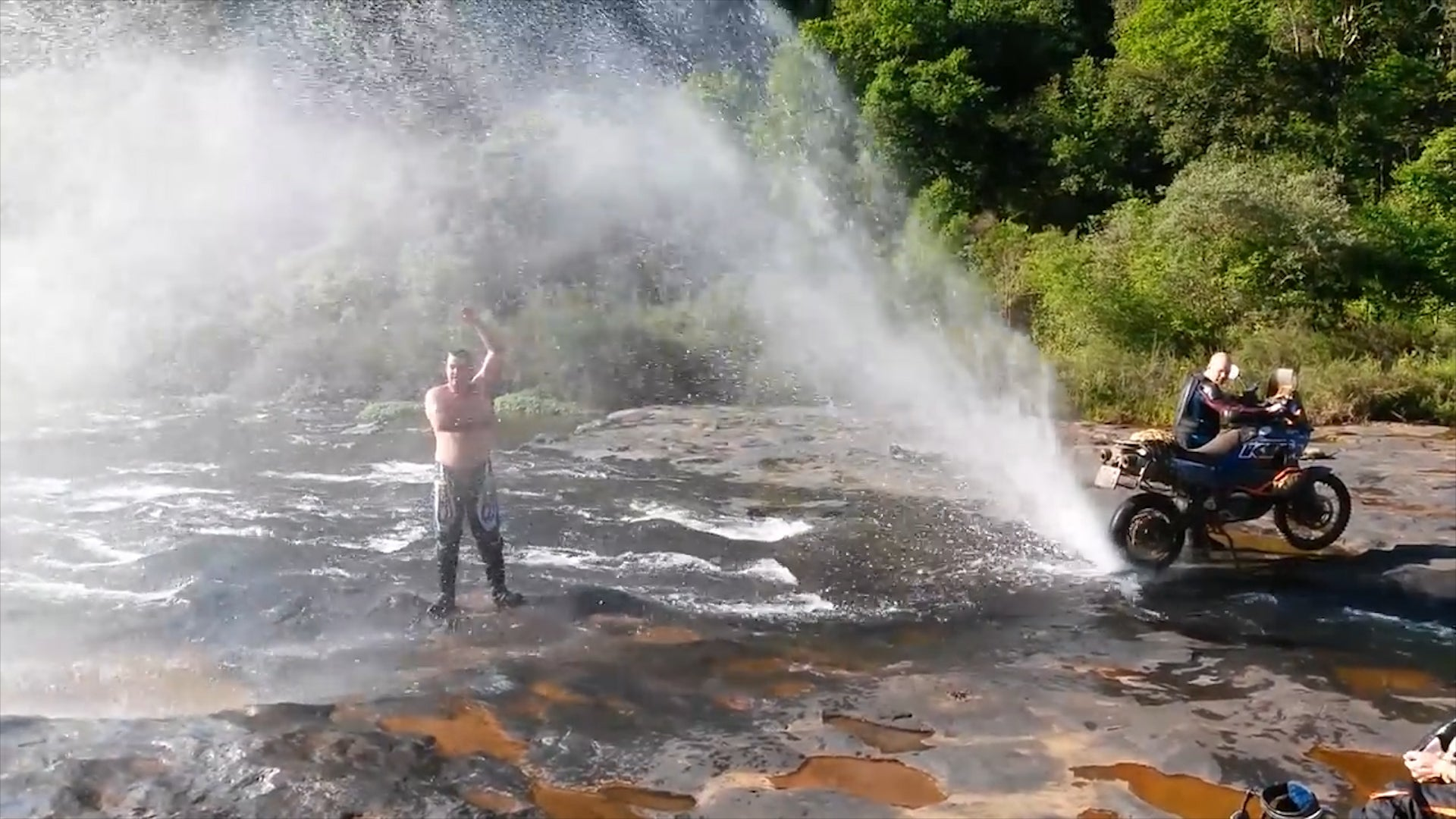Watch Guy Turn Motorcycle into Shower in South Africa