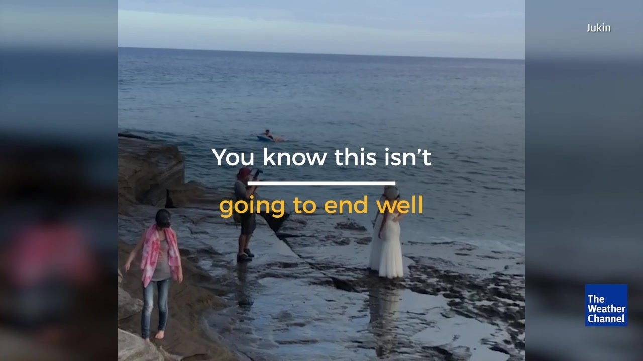 Huge wave wipes out couple during their wedding photo shoot