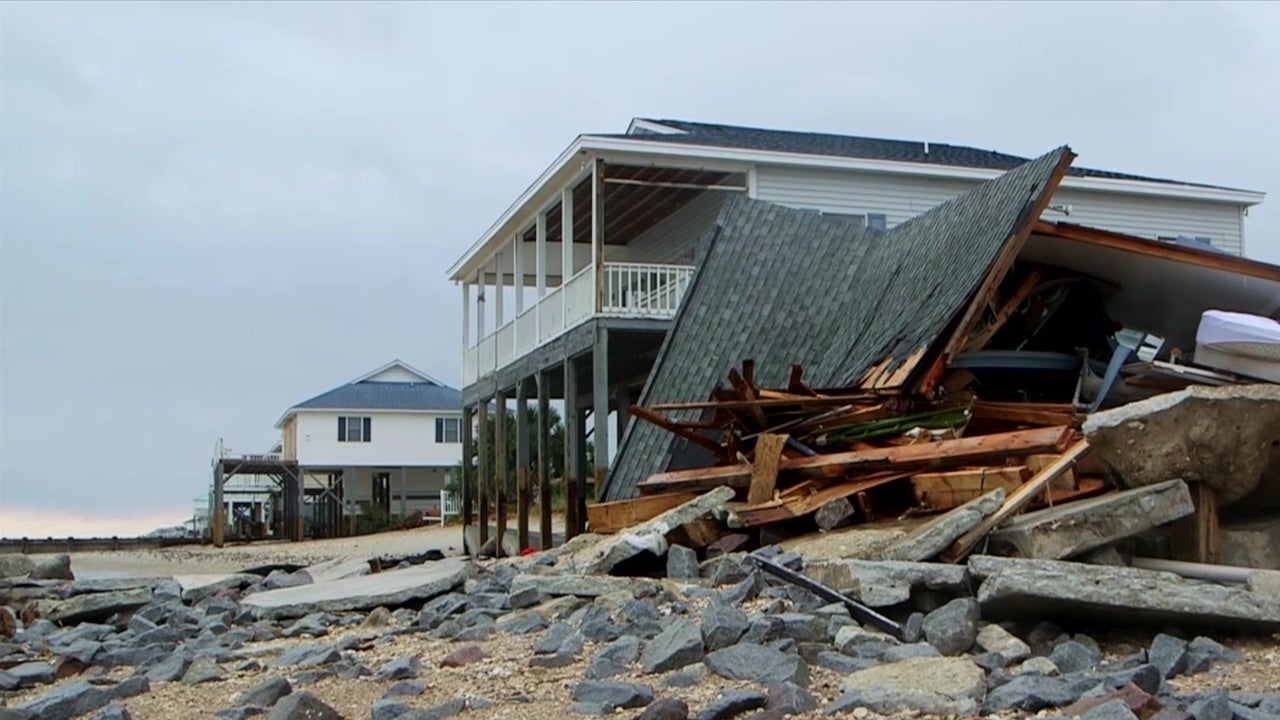 mayor surveys damaged beach town