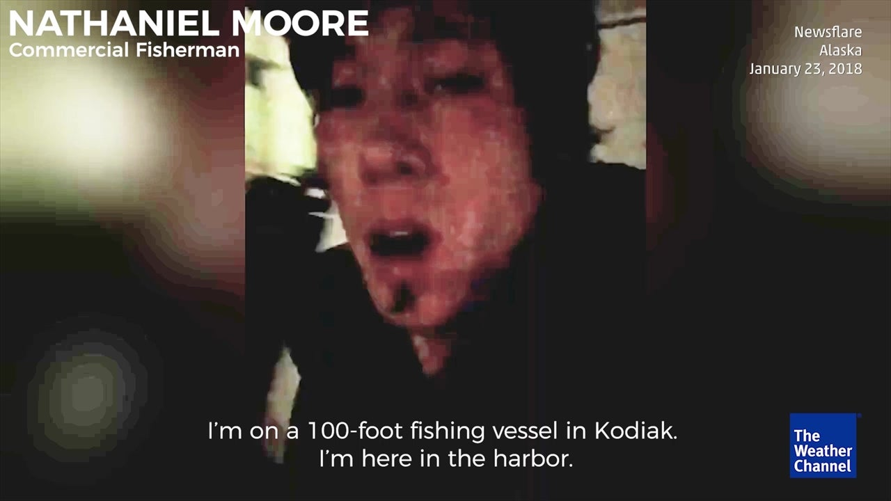 A man on a boat records a video selfie during tsunami warning evacuations on Kodiak Island, Alaska.