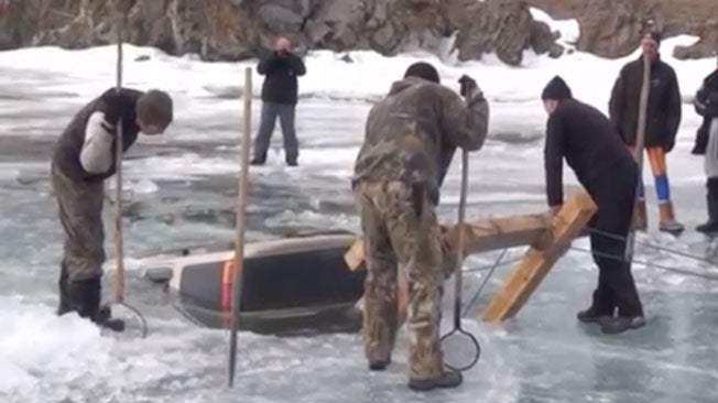 Men Pull Bizarre Catch From Frozen Lake