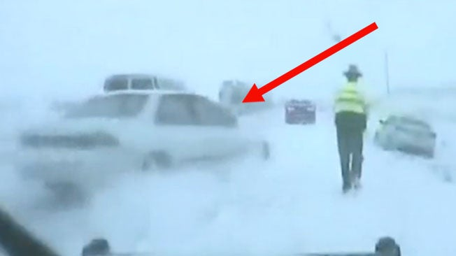 Sliding Car Narrowly Misses Trooper