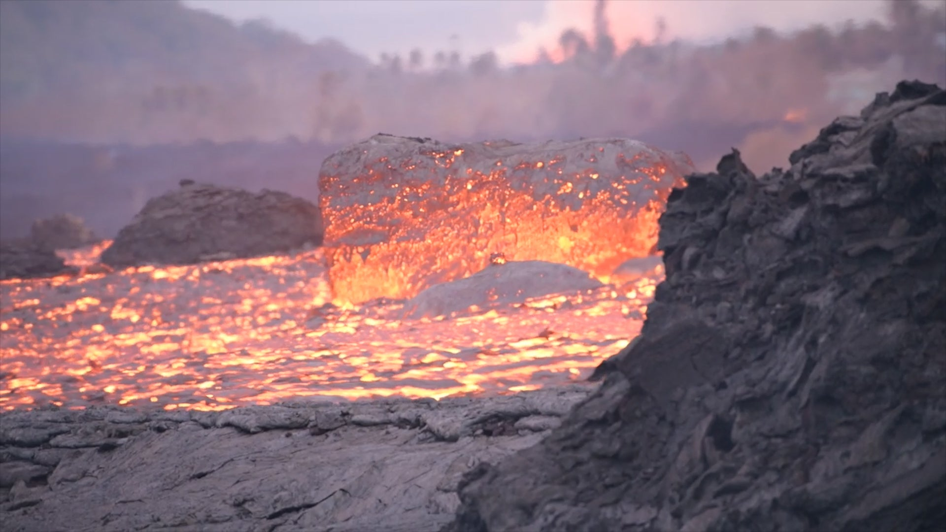 Giant Boulders Of Lava Flowing From Kilauea Volcano The