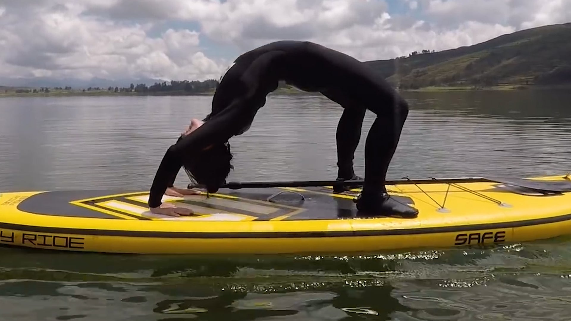 This Couple Can Do Yoga On A Paddleboard